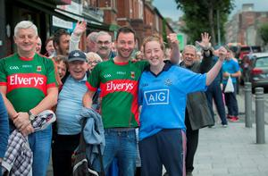 31/08/2015 GAA Fans (L to R) Craig Boyle from Kilkelly & Leanne Dicker from Walkinstown queue to get tickets for the GAA senior Semi Final between Dublin & Mayo at the GAA Ticket office on Dorset Street, Dublin