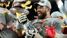 Kansas City Chiefs' Laurent Duvermay-Tardif celebrates with the Vince Lombardi trophy after winning the Super Bowl LIV REUTERS/Mike Blake