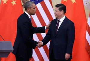 U.S. President Barack Obama shakes hands with Chinese President Xi Jinping after a joint press conference at the Great Hall of People in Beijing, China. The surprisingly warm summit between the two presidents has the potential to develop into Sino-American joint leadership at the global level. Feng Li/Getty Images