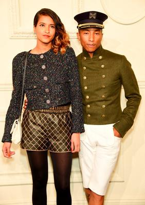 Helen Lasichanh and Pharrell Williams attend the CHANEL Paris-Salzburg 2014/15 Metiers d'Art Collection at Park Avenue Armory