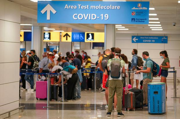 Protocol: Visitors arriving at Rome's Leonardo da Vinci airport yesterday were immediately tested for Covid-19. Italy has announced the measures for travellers arriving from Croatia, Greece, Malta and Spain. AP Photo/Andrew Medichini