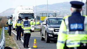 Gardai at a checkpoint ensure passengers are adhering to strict travel restrictions.