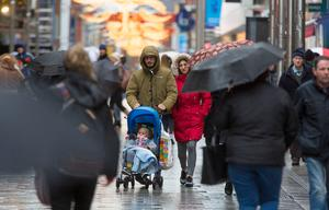 Christmas shoppers brave the rain on the capital's busy Henry Street.