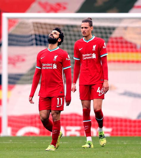 Liverpool's Mohamed Salah looks to the sky during the 1-0 defeat to Fulham. Clive Brunskill/PA Wire.