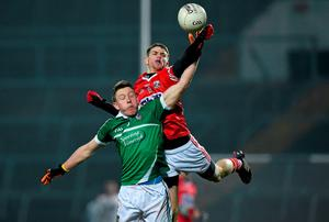 Cian Kelly, Cork, in action against Evan Quinlan, Limerick
