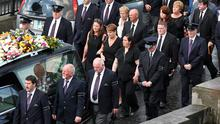 The remains of Larry and Martina Hayes are brought across the Shannon to the Church of St Peter and Paul, where their funeral mass will take place today. Photo: Steve Humphreys