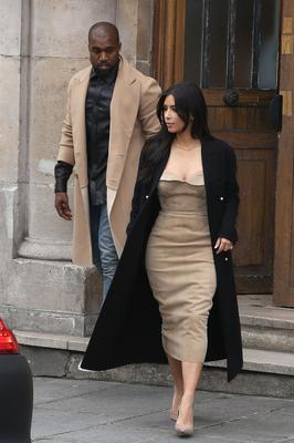Kim Kardashian and Kanye West leave the 'Maison Martin Margiela' showroom on May 21, 2014 in Paris, France.  (Photo by Marc Piasecki/GC Images)