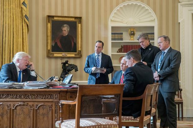 In this Jan. 28, 2017 file photo, President Donald Trump, accompanied by from second from left, Chief of Staff Reince Priebus, Vice President Mike Pence, National Security Adviser Michael Flynn, Senior Adviser Steve Bannon, and White House press secretary Sean Spicer, speaks on the phone with Russian President Vladimir Putin, in the Oval Office at the White House in Washington. (AP Photo/Andrew Harnik)