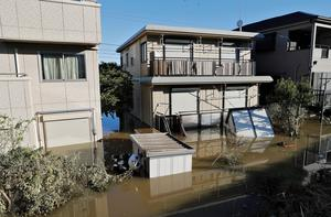 A view of houses in a flooded residential area due to Typhoon Hagibis, near the Tama River in Kawasaki, Japan, October 13, 2019. REUTERS/Kim Kyung-Hoon