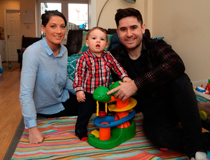 Liam Harding with his wife Niamh and their 10-month-old son LJ at their home in Stoneybatter, Dublin Photo: Caroline Quinn
