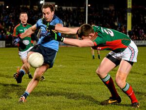 Tomas Brady, Dublin, in action against Barry Moran, Mayo