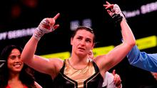 Katie Taylor has her hand raised in victory following her WBA & IBF Female Lightweight World title bout against Cindy Serrano at TD Garden in Boston, Massachusetts, USA. Photo by Stephen McCarthy/Sportsfile