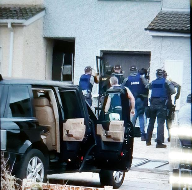 Gardai remove a window to gain entry to the property in Finglas which is linked to the 'Mr Flashy' drugs gang