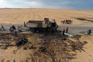 Airstrike: A destroyed truck at the spot where Isil spokesman Abu Hassan al-Muhajir was reportedly killed. Photo: AFP via Getty Images
