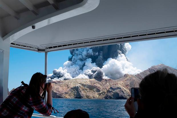 This handout photograph courtesy of Michael Schade shows the volcano on New Zealand's White Island spewing steam and ash moments after it erupted on December 9, 2019. Photo by HANDOUT/Michael Schade/AFP via Getty Images