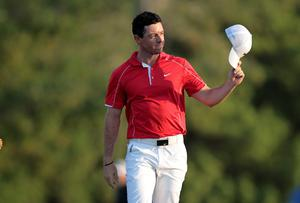 Rory McIlroy acknowledges the crowd after his approach shot to the 18th green during the opening round of the DP World Tour Championship. REUTERS/Nikhil Monteiro