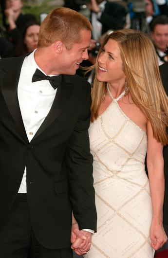 """Brad Pitt and wJennifer Aniston attend the World Premiere of the epic movie """"Troy"""" at Le Palais de Festival on May 13, 2004 in Cannes, France"""