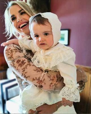 Vogue Williams with son Theodore at his christening. Picture: Instagram
