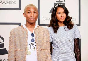 Singer Pharrell Williams and his wife, Helen Lasichanh, arrive at the 58th Grammy Awards in Los Angeles, California February 15, 2016.  REUTERS/Danny Moloshok