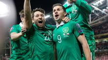 Republic of Ireland's Shane Long (right) celebrates scoring his sides opening goal  during the UEFA Euro 2016 Qualifier at the Aviva Stadium, Dublin, Ireland. PRESS ASSOCIATION Photo. Picture date: Sunday March 29, 2015. See PA story SOCCER Republic. Photo credit should read: Niall Carson/PA Wire