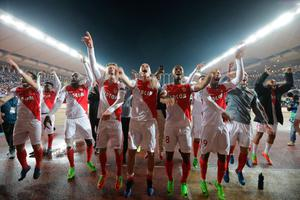 Monaco players celebrate after beating Man City