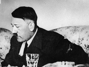 German dictator Adolf Hitler dines in a still from a private home movie