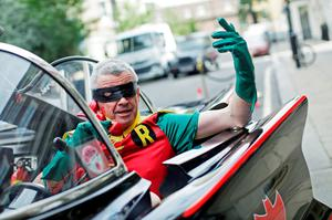 Ryanair chief Michael O'Leary dresses as superhero side-kick Robin in a replica Batmobile vehicle, as he announces the recent partnership with CarTrawler. Photo: Matthew Lloyd/Bloomberg