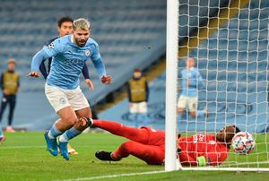 Manchester City's Sergio Aguero scores his side's second goal of the game during the Champions League match at the Etihad Stadium, Manchester.