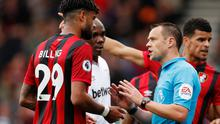 Bournemouth's Philip Billing speaks with referee Stuart Attwell after a goal scored by Bournemouth's Nathan Ake is disallowed for offside