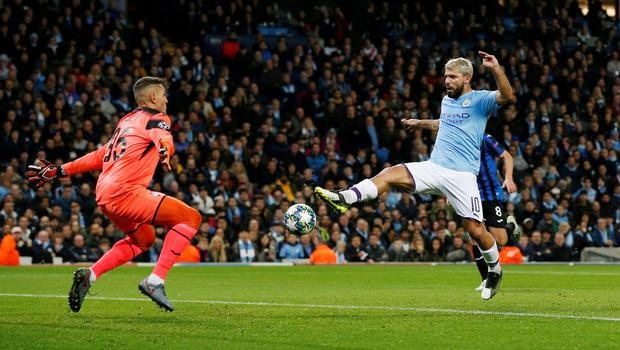 Sergio Aguero touches it past the Atalanta goalkeeper to score City's first goal of the night. Photo: REUTERS/Andrew Yates