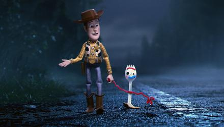 In Disney Pixar's Toy Story 4, Woody walks with Forky. Picture: Disney/Pixar