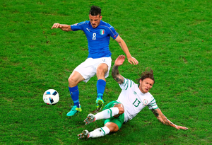 Alessandro Florenzi of Italy is tackled by Jeff Hendrick.  (Photo by Clive Rose/Getty Images)