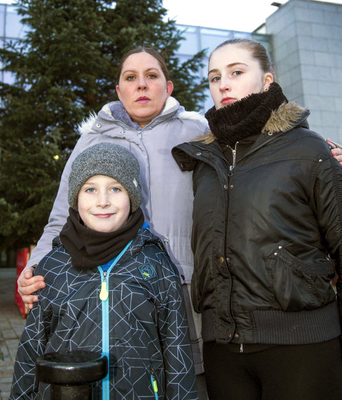 Selina Hogan and her children Scott (10) and Lauren (16) outside the family hub where they live in Ballyfermot.