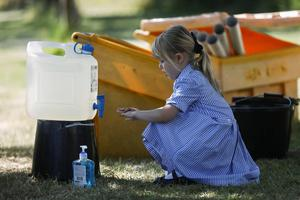 Back to school: The already-packed daily school routine will have to include regular hand-washing and sanitisation. Picture: Reuters