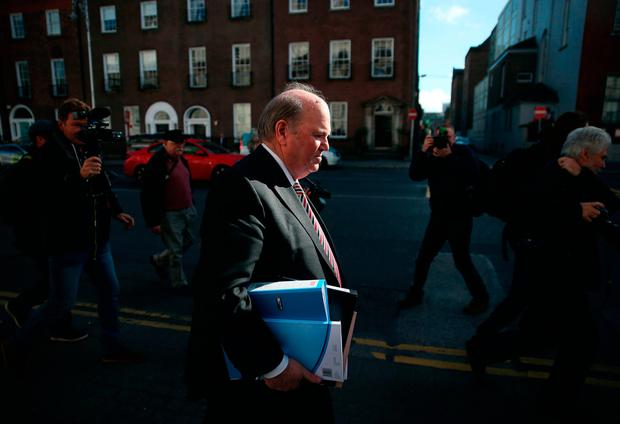 Finance Minister Michael Noonan makes his way to Government buildings in Dublin to deliver the Irish Budget. Photo: Brian Lawless/PA Wire