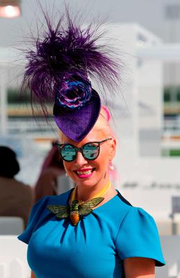 A guest arrives at the Meydan racecourse before the start of the ten million US dollars Dubai World Cup, the world's richest horse race