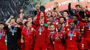 Liverpool's Jordan Henderson lifts the trophy as they celebrate after winning the Club World Cup Soccer Football beating Flamengo in the final at the Khalifa International Stadium, Doha, Qatar. Photo: Reuters/Kai Pfaffenbach