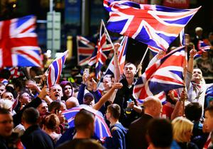 Pro-union protestors chant and wave Union Flags during a demonstration at George Square in Glasgow, Scotland September 19, 2014.
