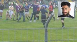 A pitch invader that ran for Paul Galvin during the Kerry senior hurling championship final in Austin Stack Park, Tralee. Galvin is in the blue jersey and black helmet.