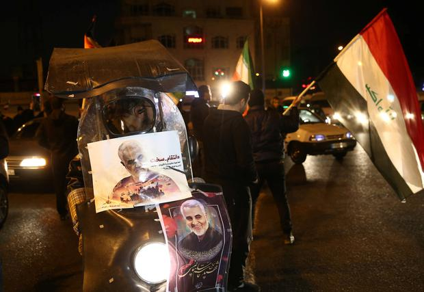 Pictures of Iranian Major-General Qassem Soleimani, who was killed in an air strike at Baghdad airport, are seen on a motorcycle, as people celebrate in the street after Iran launched missiles at U.S.-led forces in Iraq, in Tehran, Iran, January 8, 2020. Nazanin Tabatabaee/WANA (West Asia News Agency) via REUTERS ATTENTION EDITORS - THIS IMAGE HAS BEEN SUPPLIED BY A THIRD PARTY