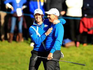 Europe's Sergio Garcia celebrates after chipping in from a bunker with playing partner Rory McIlroy during the fourballs on day one of the 40th Ryder Cup at Gleneagles Golf Course, Perthshire. PRESS ASSOCIATION Photo. Picture date: Friday September 26, 2014. Photo credit should read: Lynne Cameron/PA Wire. RESTRICTIONS: Use subject to restrictions. Editorial use only. No commercial use. Call +44 (0)1158 447447 for further information.