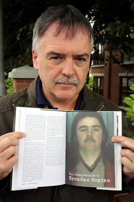 File photo dated 21/6/2013 of Kieran Megraw holding a book showing his  brother, Brendan Megraw
