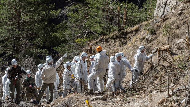 Rescue workers and investigators work at the crash site of a Germanwings Airbus A320, near Seyne-les-Alpes. The co-pilot, Andreas Lubitz, 27 of a Germanwings jet that crashed in the French Alps increased the airplane's speed before it crashed killing all 150 people on board, according to French investigators (REUTERS)
