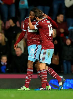 West Ham United's Diafra Sakho (left) celebrates putting his side into the lead against Sunderland with Mark Noble