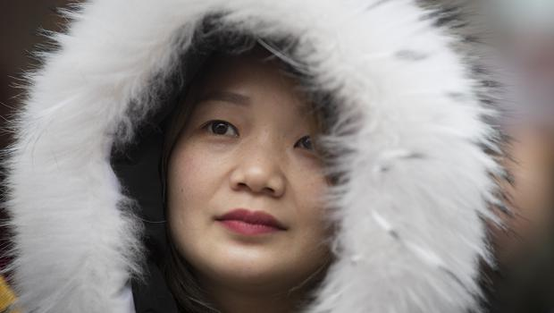 Wrapped up: Xiaohua Zheng is dressed for the cold snap as she celebrates the Year of the Rat at the Chinese New Year Festival at Hill street in Dublin's north inner city. Photo: Arthur Carron