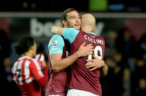 West Ham's Andy Carroll and James Collins celebrate winning after the final whistle