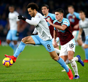 West Ham's Felipe Anderson is challenged by Burnley's Ashley Westwood.  Photo: Getty Images