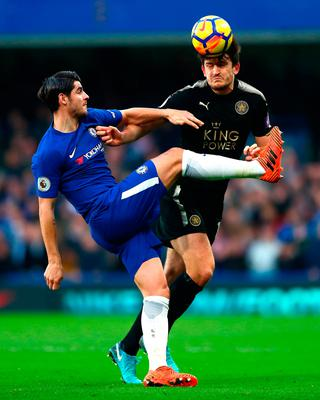 Harry Maguire of Leicester City is challenged by Alvaro Morata of Chelsea    PHoto: Getty