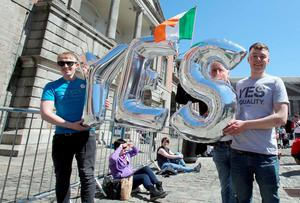 Supporters for same-sex marriage hold an inflatable Yes sign as they wait for the announcement on the referendum in Dublin castle on May 23, 2015. Ireland appeared to have voted to allow gay marriage today in a historic referendum which would see the historically Catholic country become the world's first to make the change after a popular vote. AFP PHOTO /  Paul FaithPAUL FAITH/AFP/Getty Images