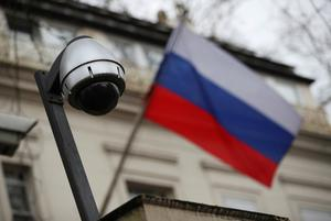 FILE PHOTO: A security camera is seen, and a flag flies outside the consular section of Russia's embassy in London, Britain, March 15, 2018. REUTERS/Hannah McKay/File Photo